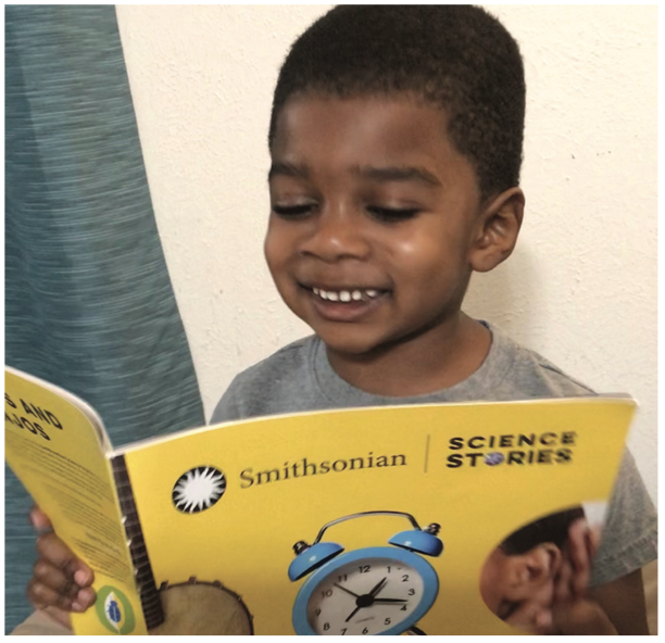 Image of young student reading Smithsonian Science Stories